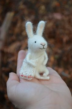 Traveler Little Bunny  by Felting Dreams  Ready by feltingdreams, on etsy $68.00 These adorable felted bunnies, mice, gnomes and foxes are Handmade in Chile by Johana Molina each unique in their own way with their own little personalities, sweaters, bags and scarves, I just want one of each for my own!