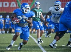 Slideshow: Fall Sports Return to Practice — Georgia State University  Top running back Donald Russell carries the football.