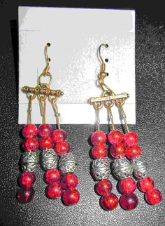 Red crackle bead earrings with silver spacers  10.00$