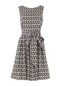 Vintage inspired dress in quirky cat print. Fit and flare shape with front pockets, waist belt and black zip to fasten. 100% organic cotton.
