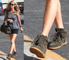 How to Wear Wedge Sneakers with a Slim Black Miniskirt Like Nicky Hilton