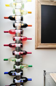 Calvin's Naturally Stylish DC Home Rainbow via Barefoot wine bottles Ikea Wine Rack, Wine Rack Wall, Wine Racks, Apartment Living, Apartment Therapy, Bars For Home, Decoration, Home Organization, House Tours