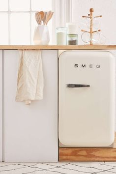 """Love it but pricey at $999 for a mini! Smeg Mini Refrigerator 16""""w x 22""""d x 28""""h 65 lbs - Interior space: 1.5 cu. ft - This item requires a 6"""" gap on the hinged side to allow the door to open properly"""
