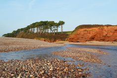 The mouth of the river Otter with its distinctive red Devon cliffs. Apparently the red colour is an indication that many millions of years ago this area was actually desert, quite a contrast from the lush green countryside we can see today. Budleigh Salterton | South Devon | England