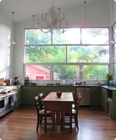 love the windows and classic breakfast table in the kitchen Plenty of counter space.  Maybe a slightly large chandelier?