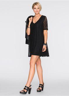 Szép ruha V-nyakkivágással és csipkebetétekkel. Hossza a 40/42-es méretben kb. 92 cm. Felső anyag: 100% poliamid; Bélés: 100% poliészter