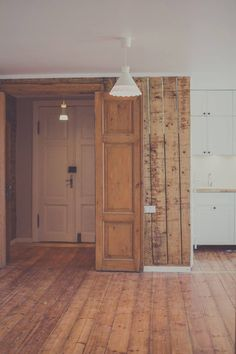 Vintage hardwood wall with IKEA kitchen in background