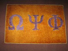 Omega Psi Phi Carpet Art – Royal Purple on Gold Never forget what it means to be part of the Omega Psi Phi fraternity, whose rich history is founded on a mission to uplift our communities, and whose b