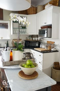 Look at that shelf in the corner over the toaster.  Love it for more space!  Lots of great decorating in this gal's kitchen too!