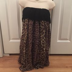 Angie leopard tube top dress size S Angie leopard tube top dress size S. Super cute and 100% Rayon. Really soft good for summer tag size M but its S or XS Angie Dresses Mini