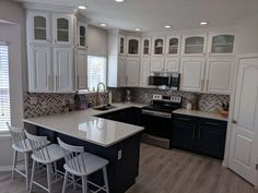 Two tone kitchen refinished by Chameleon Painting SLC Utah. Tops extra white, bottoms Benjamin Moore Old Navy. Furniture, Refinishing Cabinets, Kitchen Refinishing, Home, Cabinet, Two Tone Kitchen, Refinishing Furniture, Kitchen, Laundry Room Cabinets