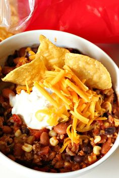 Taco Soup-1 lb ground hamburger  1 cup diced onions  1 can pinto beans, drained  1 can black beans, drained and rinsed  1 cup frozen corn  1 can diced tomatoes with chilies (like Rotel)  1 can diced tomatoes  1 can diced green chilies  1 small can tomato sauc  1/4 cup salsa verde  1/4 cup taco seasoning  1 dry ranch packet