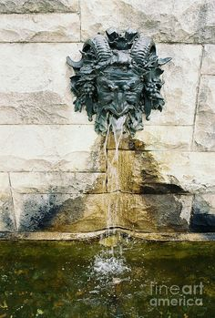 The Satyr fountain adorning the wall of the South Terrace at Biltmore Estate http://writerlysam.com/2014/04/07/architects-of-illusion-echoes-of-olympus-1-fountain-of-hippocrene/