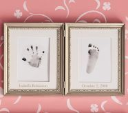 first hand and foot print, framed.