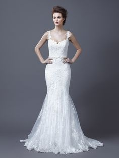 """Hanako"" is a fit and flare ivory bridal gown with lace detailing and straps by @Enzoani."