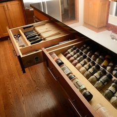 spice storage in long pull out drawer by stove.  Also like the knife drawer