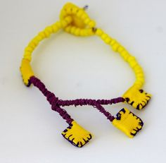 Fylaxta means Amulets Colored Wire, silk fabric, glass beads