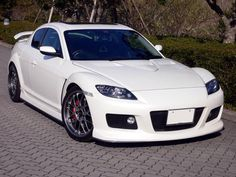 Mazda RX-8. I had a red one (: it was my baby