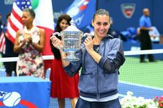 Flavia Pennetta holds aloft the women's singles trophy after defeating Roberta Vinci at the 2015 US Open.