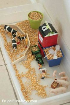 , Farm Sensory Play for Preschoolers - An orange juice container makes a simple grain silo that. , Farm Sensory Play for Preschoolers - An orange juice container makes a simple grain silo that really loads corn into a toy tractor! Sensory Table, Sensory Play, Farm Sensory Bin, Toddler Sensory Bins, Sensory Boxes, Toddler Play, Sensory Diet, Montessori Toddler, Farm Activities