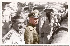 Then-General (later Field Marshal) Erwin Rommel in a trench near Tobruk, along with an officer from the Italian contingent that accompanied Rommel on this tour (September 1941, partially colorized by Doug)