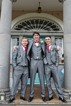 3 piece traditional grey morning suits / tails with Red cravats & bow ties - Image by Inspired by Love Photography by Sona - Maggie Sottero gown & red Christian Louboutin Shoes for a vintage inspired wedding in Ireland with Ted Baker bridesmaid dresses, red lipstick, glitz & glamour.