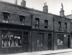 A haberdashery and a grocer store at numbers 261 - 265 Brick Lane, Old London, London Brick, East End London, Victorian London, Victorian Life, Vintage London, London History, British History, Local History