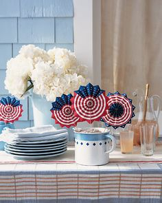 Patriotic Fans                                                        Wave away the heat, and proclaim your allegiance, with these red, white, and blue party favors.