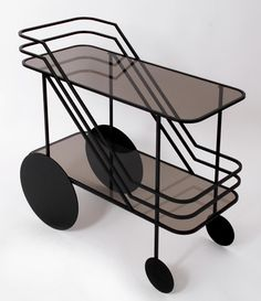 Bar cart, tea trolley or whatever you may call it, this fabulous rolling device can be the perfect home accoutrement. Whether it be a minimalist design or gold-plated shine, bar carts are a blank slate just waiting to be loved and accessorized. Serving Trolley, Tea Trolley, Black Bar Cart, Mobiles, Post Holiday Blues, Rolling Bar Cart, Modern Furniture, Furniture Design, Portable Bar