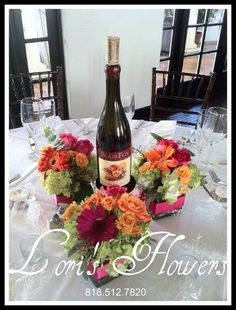 ideas using a bottle of wine as a centerpiece on tables for bridal shower | Found on wwcdn.weddingwire.com