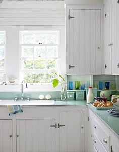 100 Country Kitchen Ideas to Inspire the Heart of Your Home bead board cabinets. love the counters. Cabinets from the get an easy update with the addition of bead-board doors plus new, modern knobs and pulls. (from Country Living) Shabby Chic Beach, Shabby Chic Homes, 1930s Kitchen, Vintage Kitchen, Beach Cottage Kitchens, Home Kitchens, Country Kitchens, Coastal Kitchens, Bungalow Kitchen