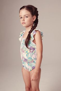 da264a1313 Egg Flutter Sleeve Swimsuit Floral.The ruffle detail on the straps add a  girly touch
