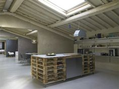 Modern Minimalist Loft in Florence...I just like the stacked pallet work table. Great storage.