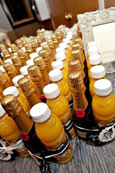 Orange juice and champagne wedding favors. Love this! You could also have fresh fruit so your guests could have a complete breakfast snack.