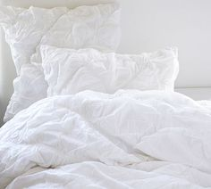 Our beautiful duvet, so gorgeous in my room!  Taylor diamond Ruched - Pottery Barn