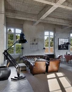 industrial loft space, leather, oversized black task lamp = killer.