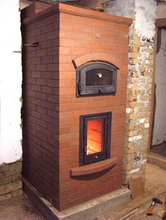 Double bell stove withheat exchanger in Romania.