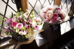 Pink Spring bridal bouquets of tulips, hyacinth, ranunculus and roses - Cain Manor