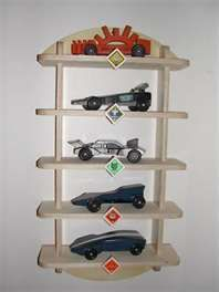 Pinewood Derby Shelf  Great idea for all of the pinewood derby cars he's made and will make!