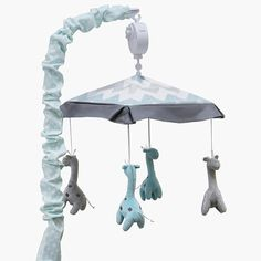 """The Peanut Shell Uptown Giraffe Musical Mobile - unfortunately this does not fit our crib because we do not have a """"standard crib"""""""