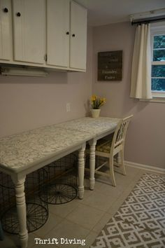 Cut a table in half, stack them sideways, and make a long folding table in the laundry room. - Thrift Diving Blog