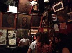 """Bar Pastis"" Barcelona is a cosy little arty bar, about the size of a small living room, decked with paintings, sketches and prints layered with nicotine."