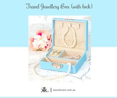 Delight yourself, your girlfriend or family this Christmas with this exclusive Kazzi Kovers Blue Travel Jewellery Box (with lock).  Whether you're travelling overnight or for a grand holiday, this lockable blue case is lightweight and compact. It has been designed to fit snug in your handbag, carry-on, tote, suitcase and hotel safe.  Includes 4 separate compartments, 3 necklace/bracelet hooks and an elasticised pocket.  Available in Blue, Pink, Black and Mauve colours.