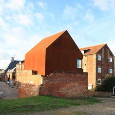 A Corten steel artist's studio inserted into a ruined Victorian dovecote in Suffolk, UK.