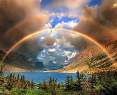 """Wow. Photographer Jeff Berkes captured this summertime stunner over St. Mary's Lake at Glacier National Park in Montana. """"As the storm came overhead at sunrise, the clouds began to break, letting light pass through onto the distant mountains. The most epic sunrise I have ever witnessed unfolded in front of us in the matter of seconds and for the next 90 minutes, we enjoyed rainbows and double rainbows over the lake."""" Photo courtesy of Jeff Berkes ."""