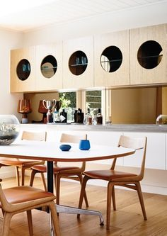 A circular motif is repeated throughout the house, including in the dining room joinery and the bathroom mirrors.