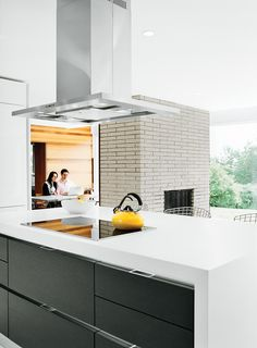 The cooktop and oven are Miele, the counter-top is Caesarstone, and the refrigerator is Liebherr.  Photo by Jon Snyder.