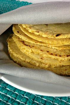 Authentic Mexican Homemade Corn Tortillas are the best. They're better than the store bought version, are pretty healthy and are a great gluten-free option.