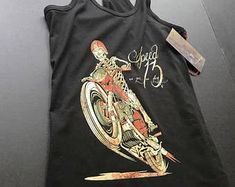 Women's Black Biker T Shirt Biker Chick Blouse Motorcycle | Etsy Biker T Shirts, Tee Shirts, Tees, Floral Maxi Dress, Chiffon Dress, Biker Chick, White Silk, Embroidered Blouse, Christmas Desserts