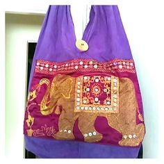 Hobo bag Beautiful natural dyed elephant bag from India, hand embroidered with sequins and hand painted wooden beads on straps. Large interior and small zippered pocket inside with strong bottom. Makes for a great summer bag. Bags Hobos